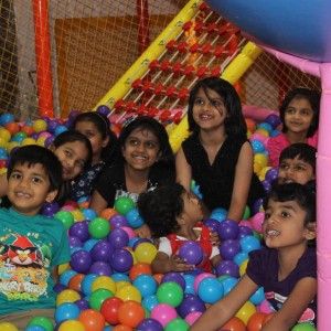 Group of Young Childern enjoying the birthday party with balls organised by the Birthday Party organizers