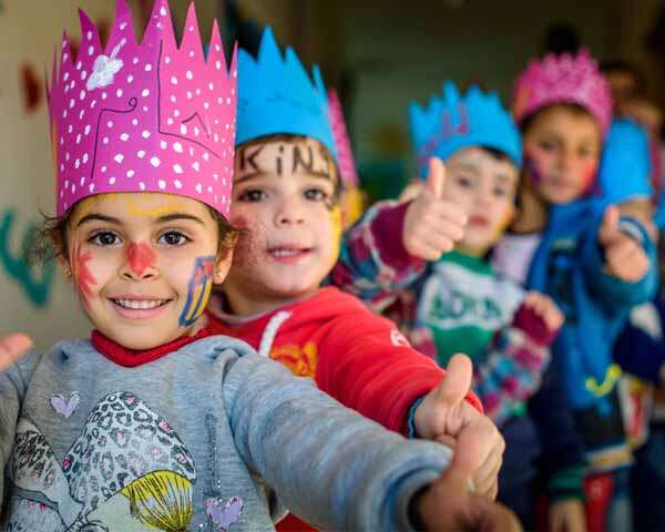 Cute & Happy Children Showing Thumbs Up In A Party Celebration.